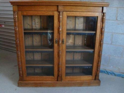 victorian golden oak 2 door glazed adjustable bookcase
