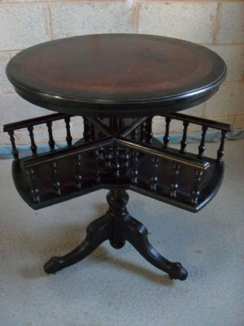 Unusual Victorian Ebonised And Gilt Mahogany And Leather Top Circular Table  Revolving Bookcase