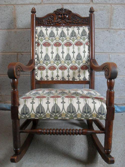 Superb Victorian Carved Oak Green Man Upholstered Rocking
