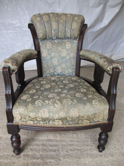 victorian ebonised mahogany upholstered showood tub shell back armchair