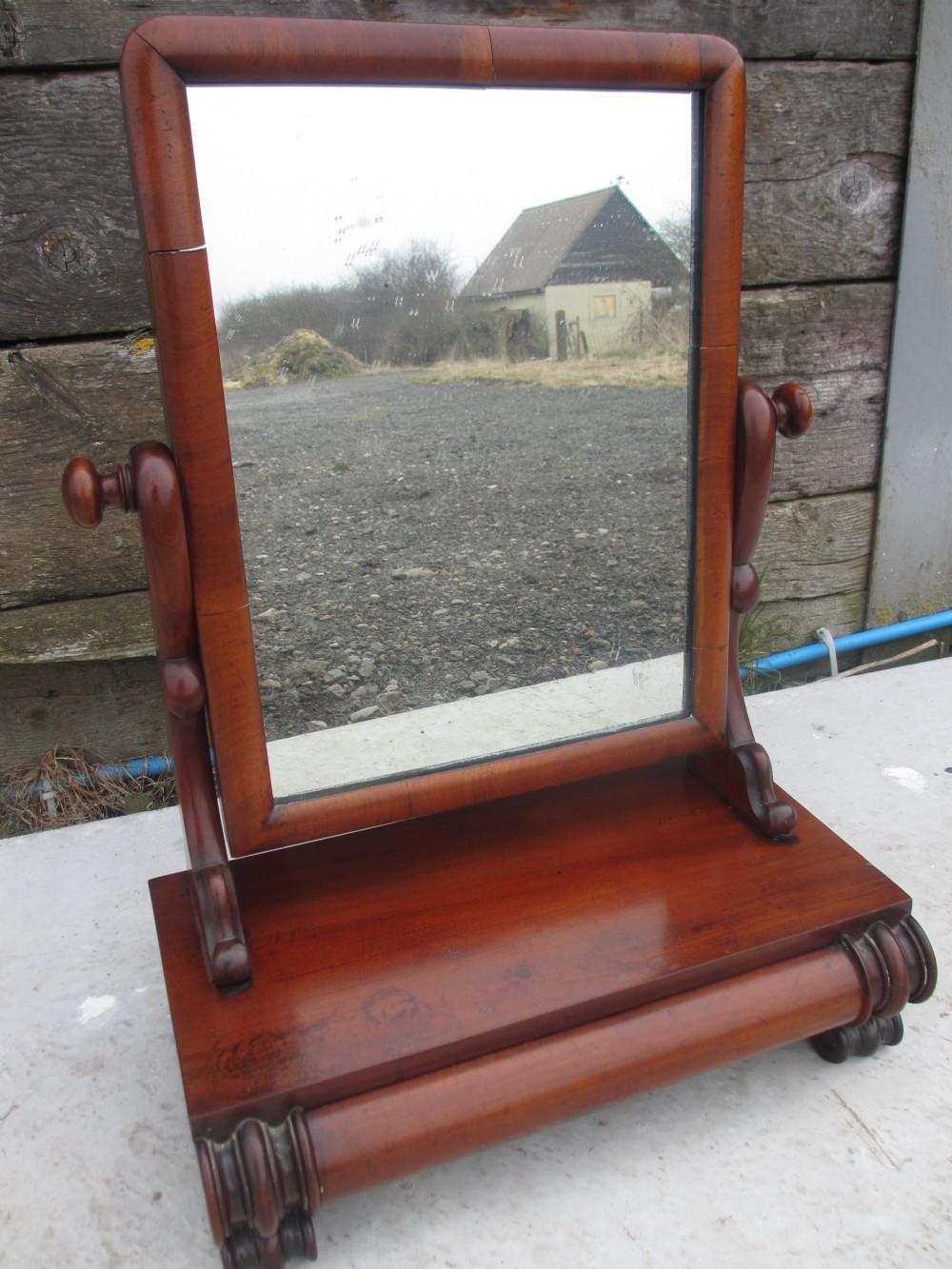 Rectangular swinging mirror