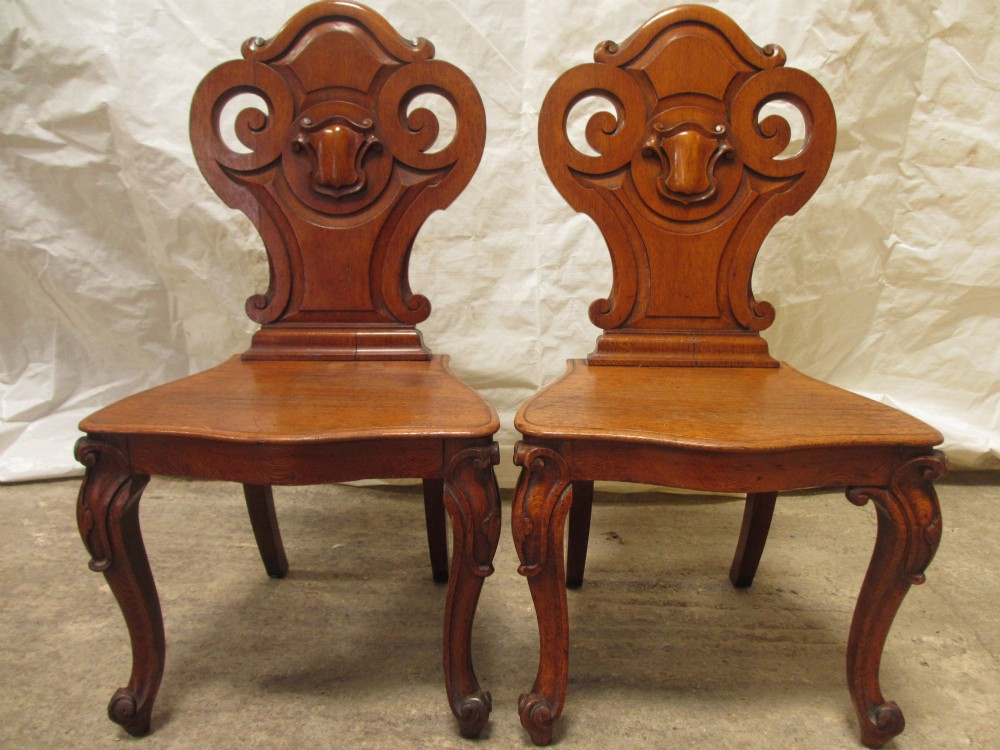 quality pair of victorian carved golden oak hall chairs