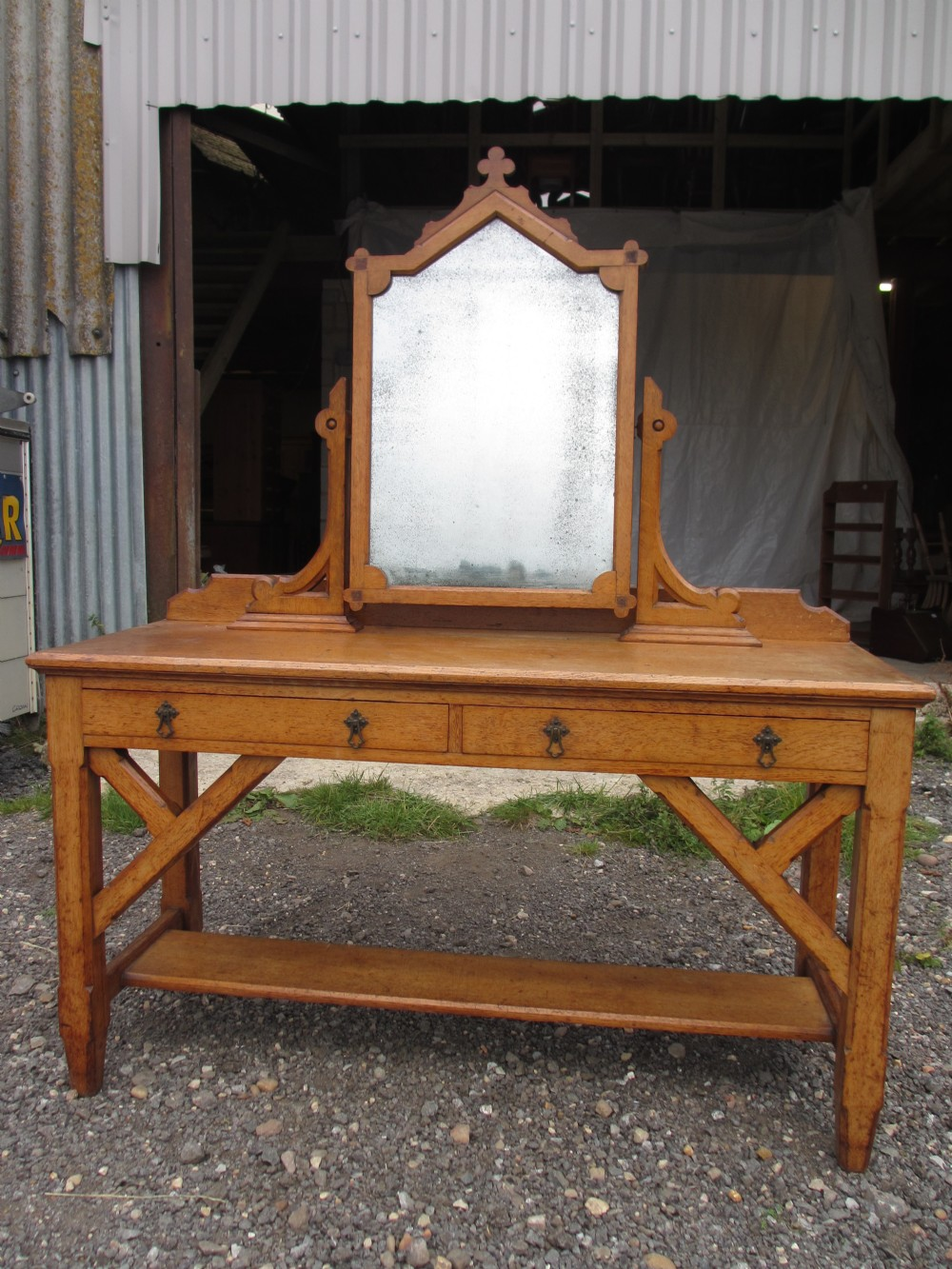 superb victorian carved oak gothic revival swing mirror dressing table two apron drawers canted corners to supports with washstand stretcher