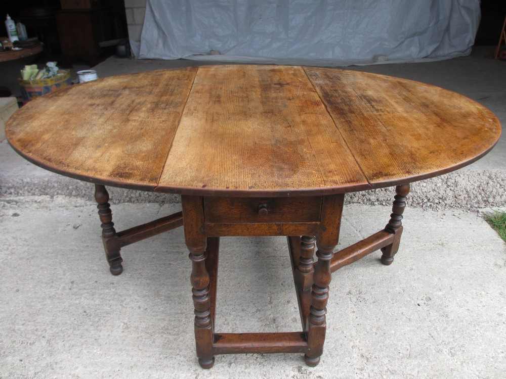 antique oak oval dining table. large victorian oak oval gate leg drop leaf dining table with turned supports and box stretcher. antique photo t