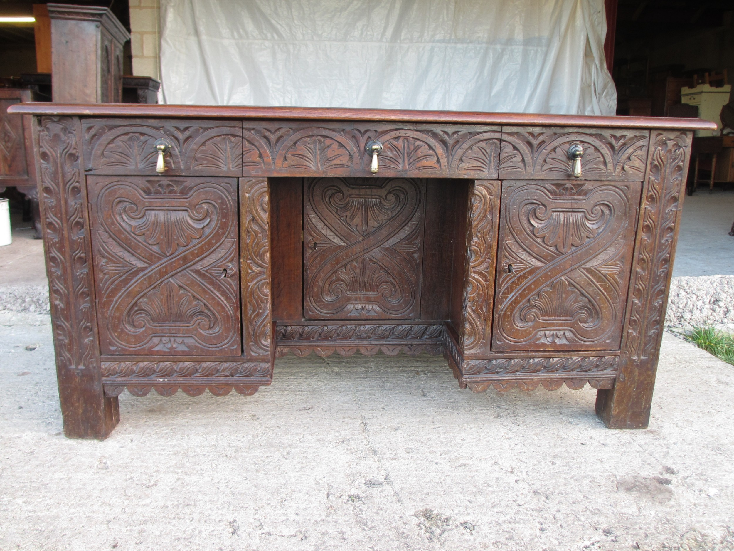 victorian heavily carved oak kneehole desk 2 cupboards 3 drawers