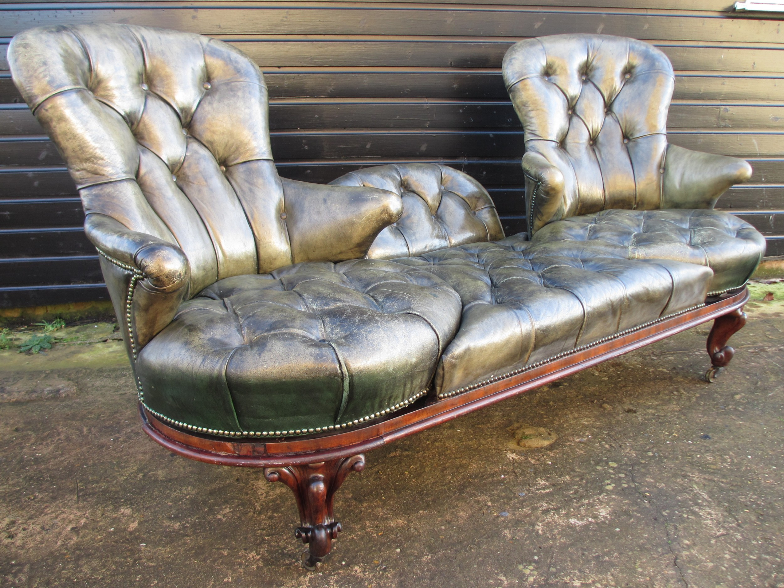 unique victorian deep button leather and rosewood swivel conversational sofa
