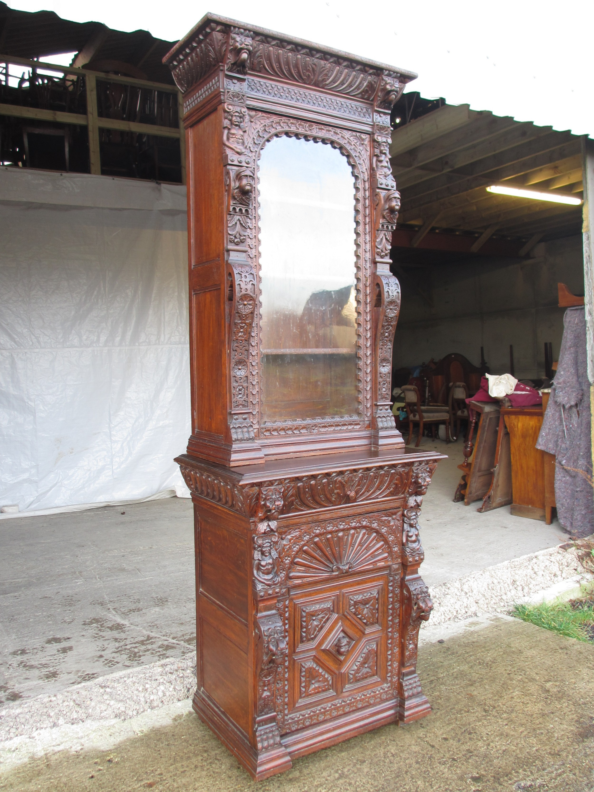 superb victorian tall 2 part carved oak glazed bookcase with drawers to lower