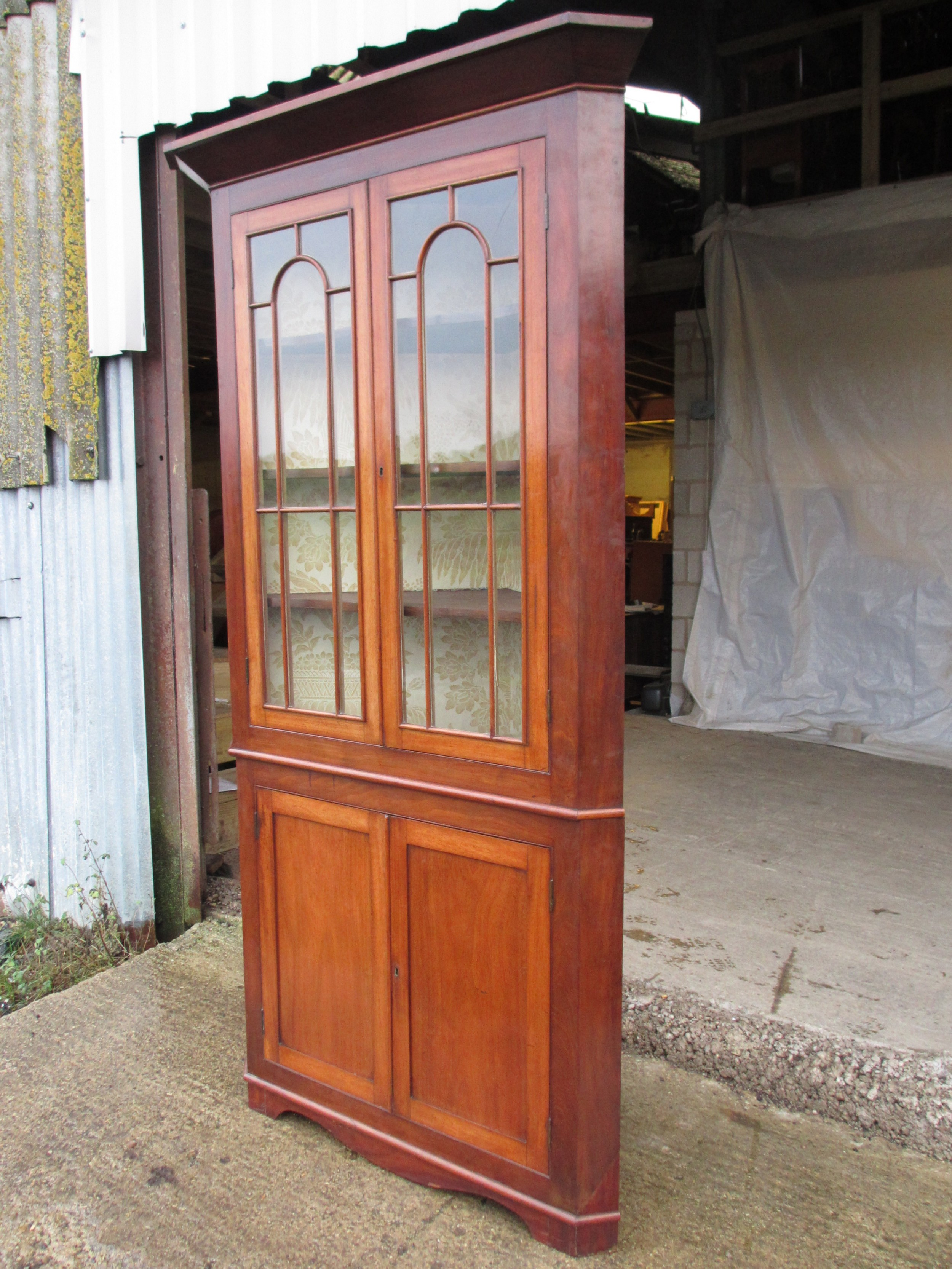 19th c mahogany glazed 2 part corner cabinet with shelves and cupboard