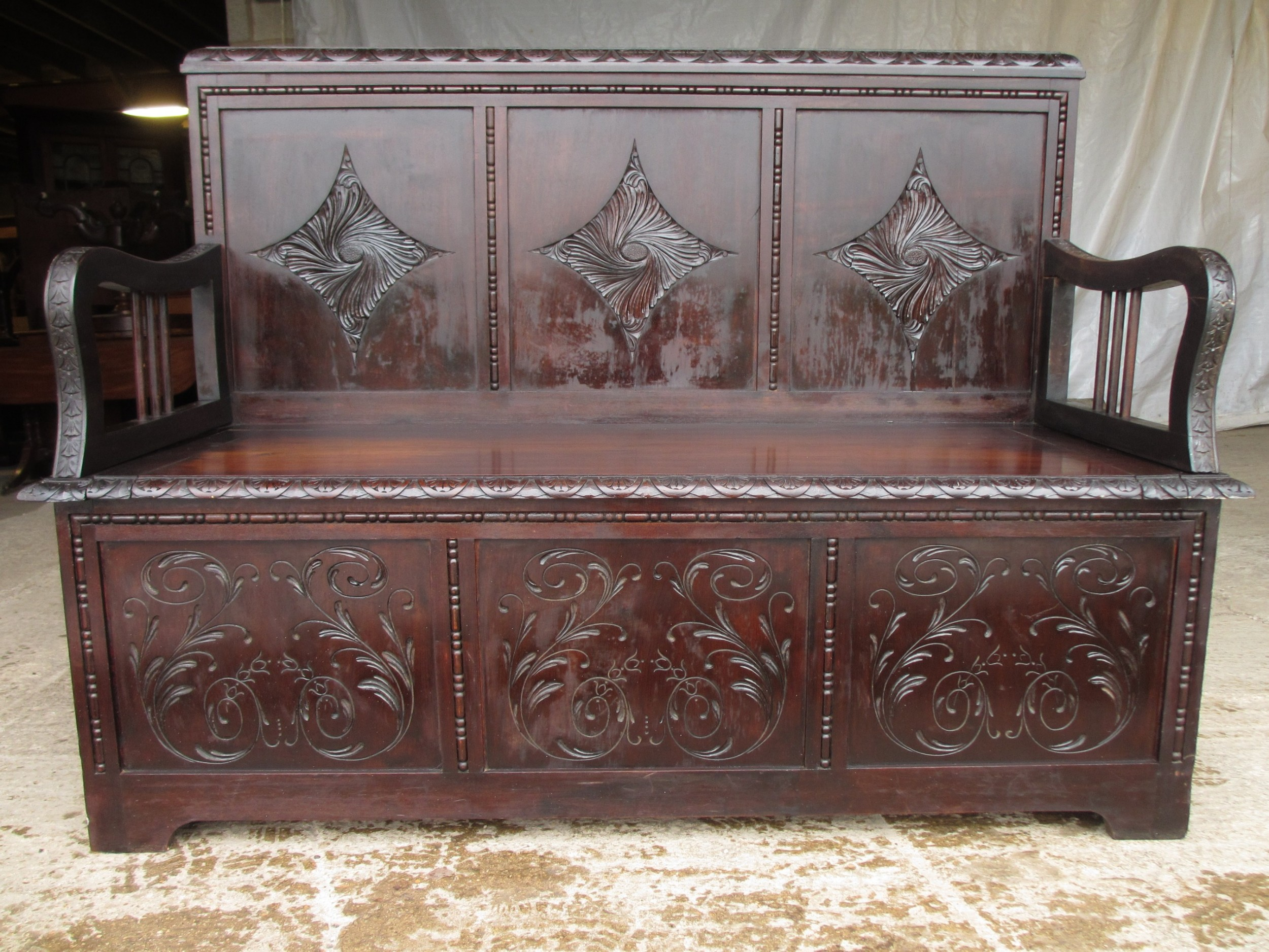 carved brazilian mahogany panelled box settle