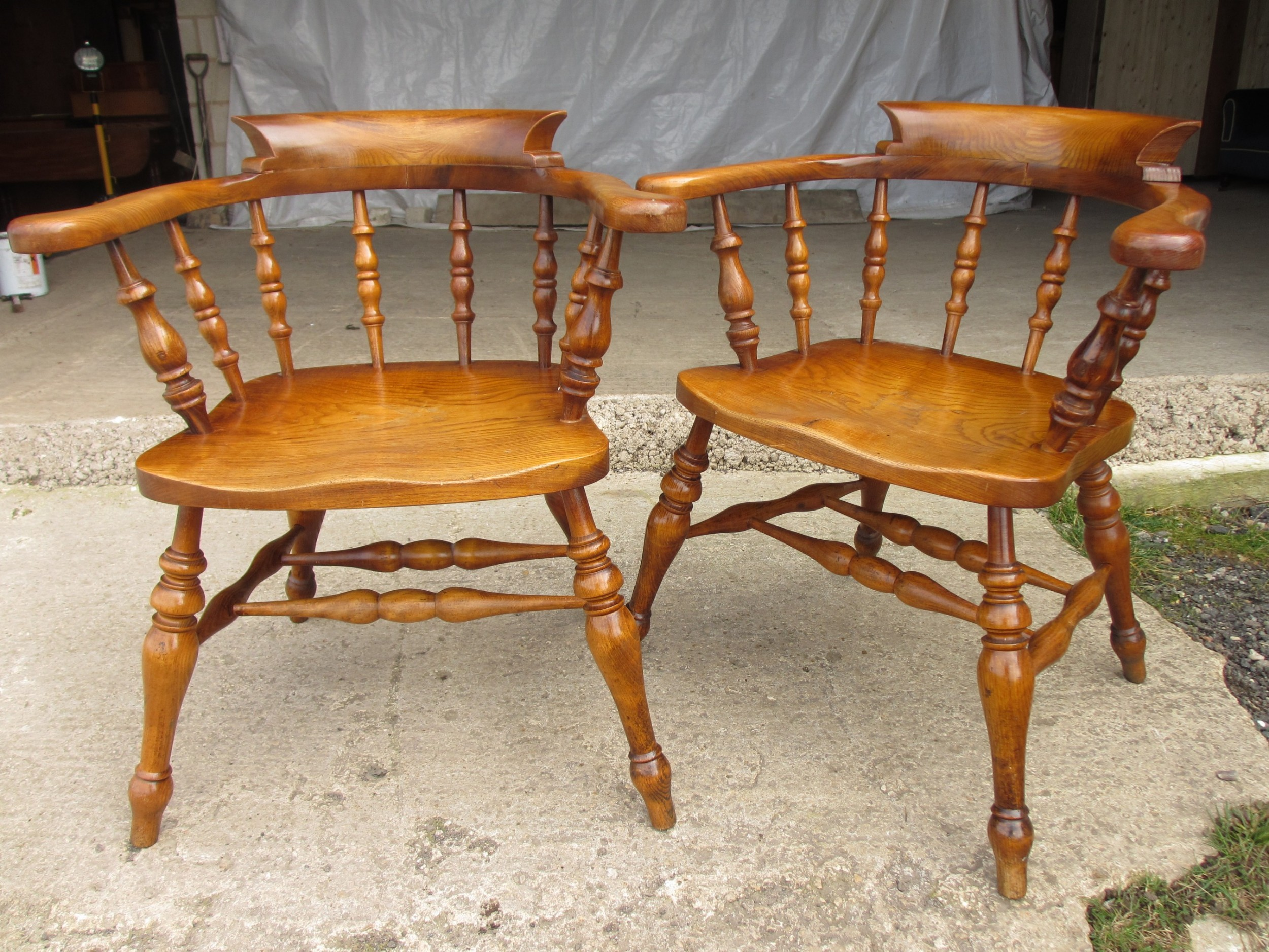 pair of 19th century elm seated captain smokers bow arm chairs