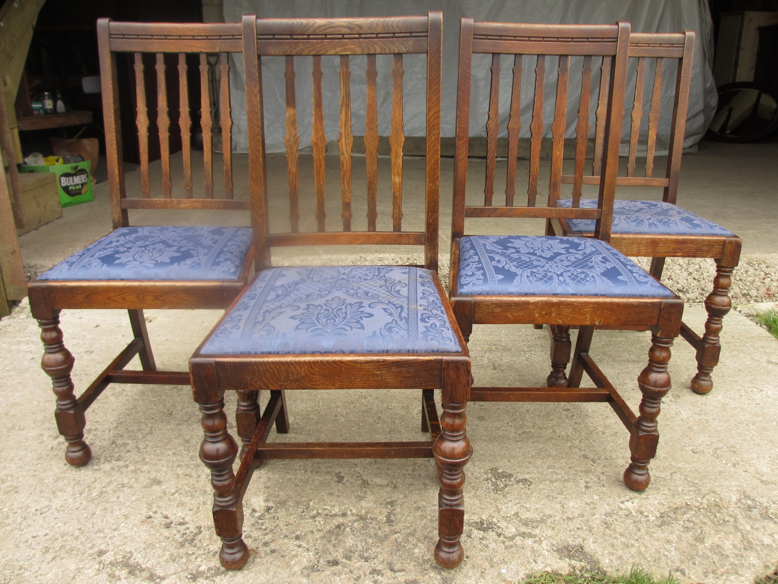 four late 19th century oak slat back dining chairs