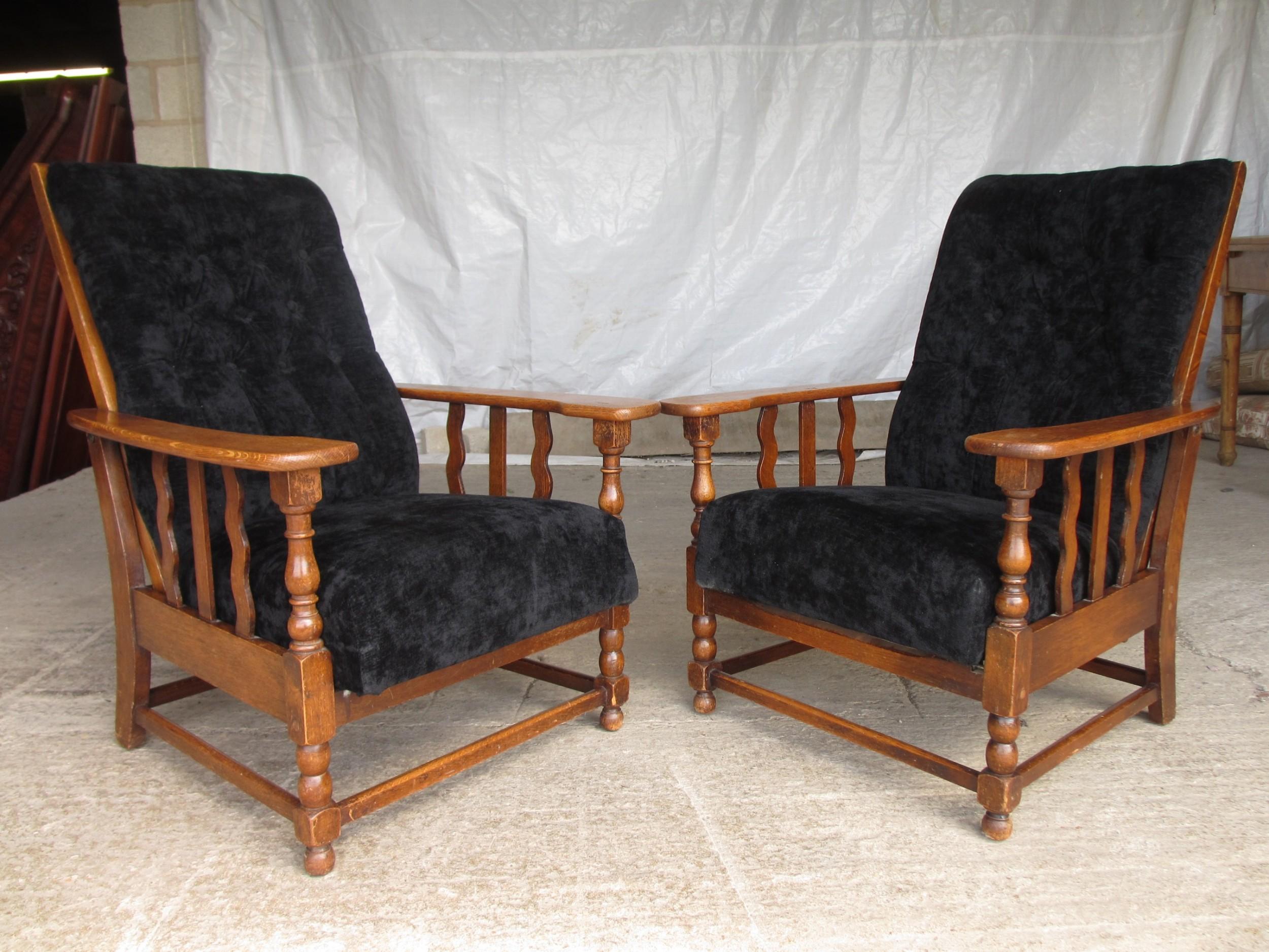 a pair of edwardian oak plantation style art deco adjustable lean back armchairs