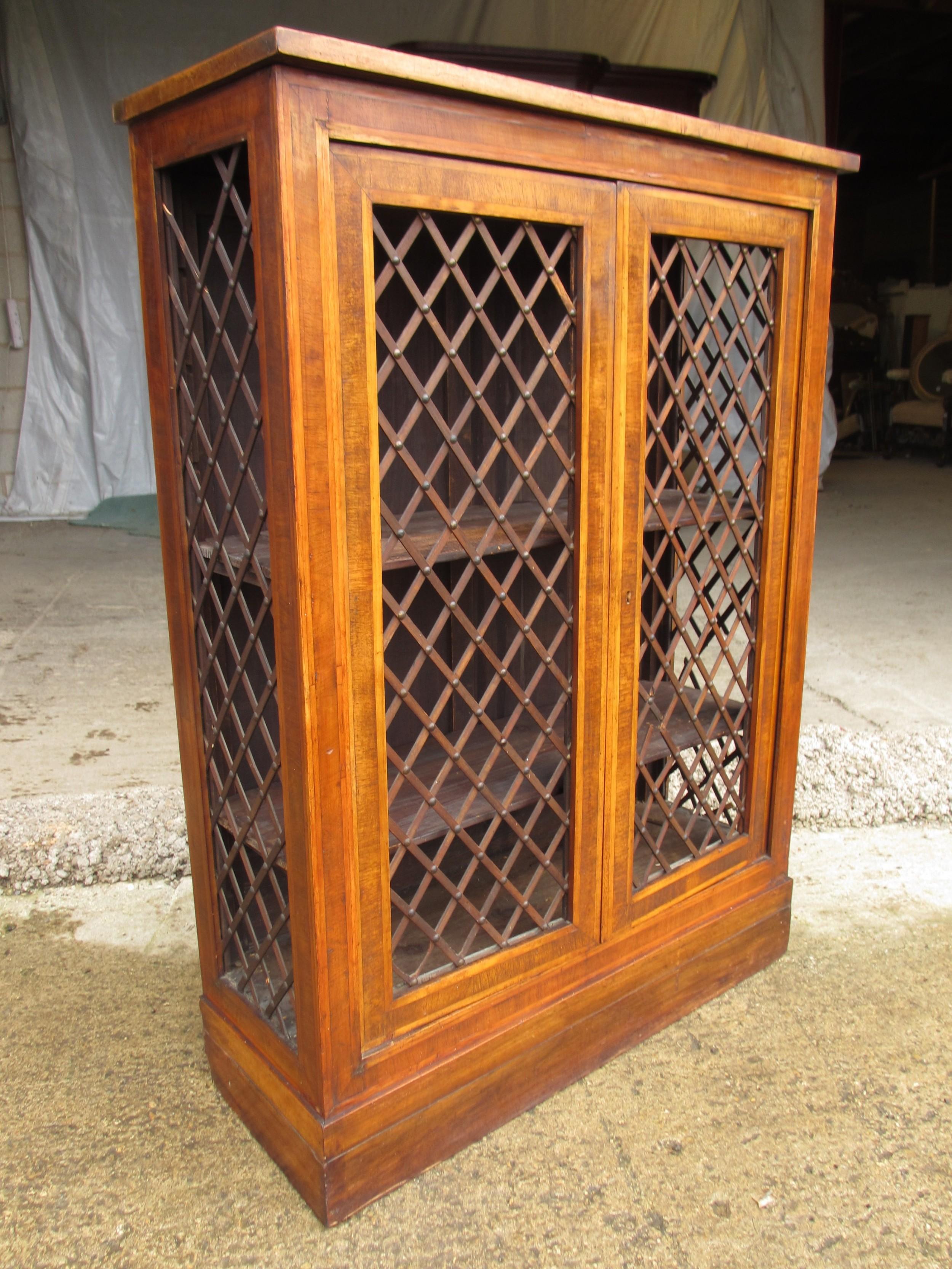 regency mahogany and walnut bookcase cabinet