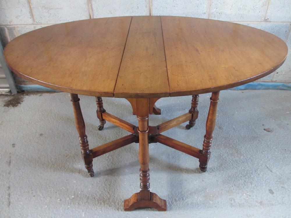 Victorian walnut oval drop leaf sutherland dining table for Antique drop leaf dining table