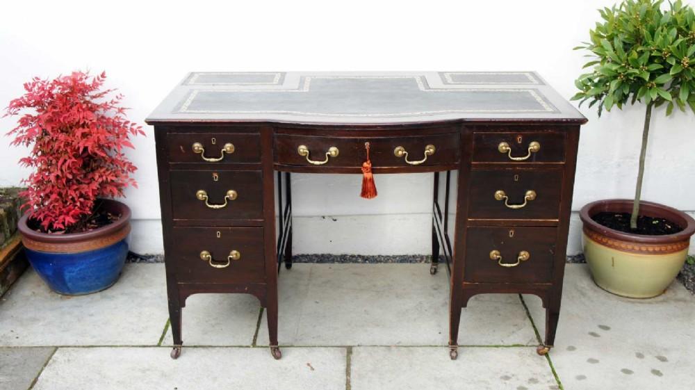 edwardian mahogany 7 drawer serpentine fronted desk leather top refurbished