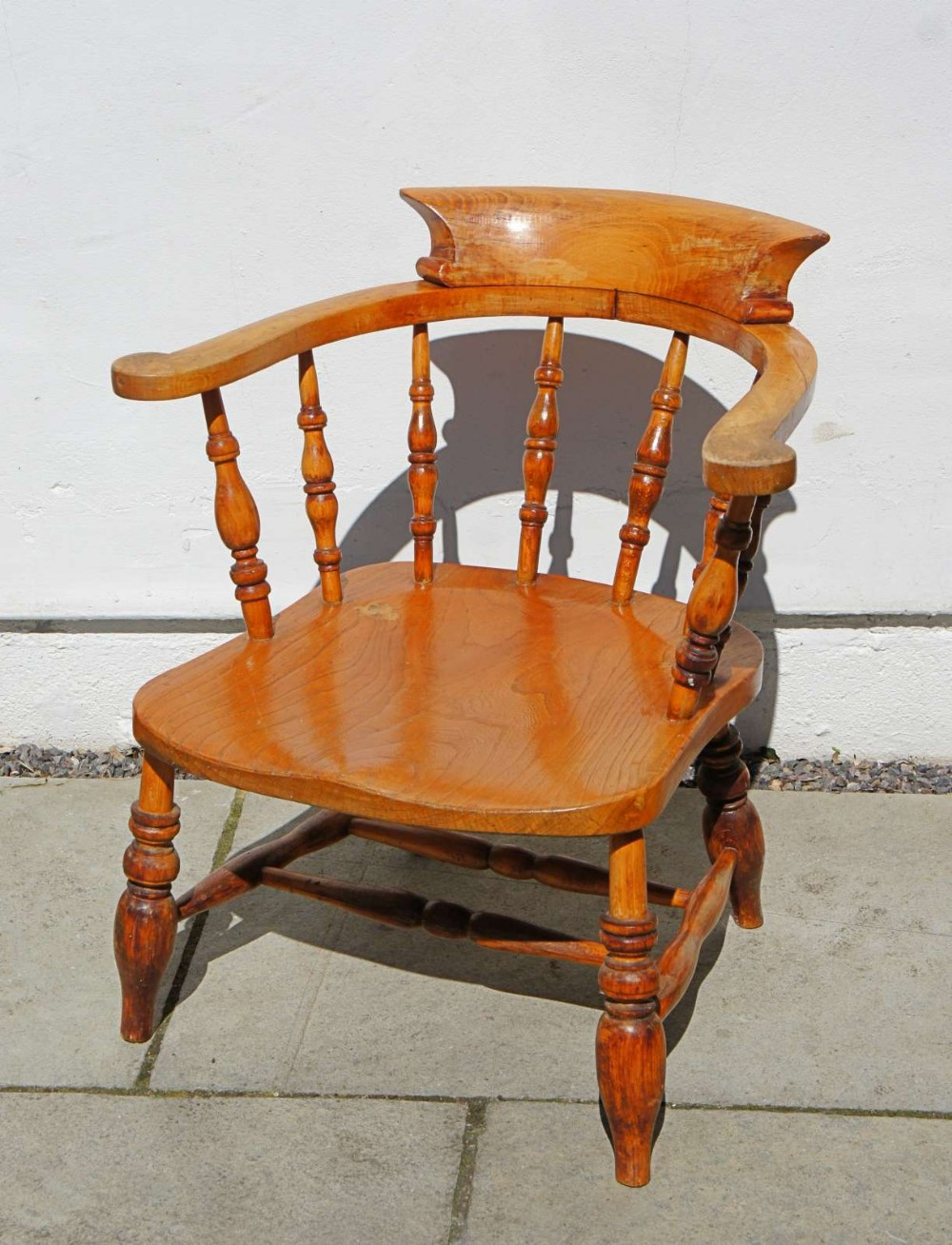 early 20th c smokers bow or captains chair beechelm light colour