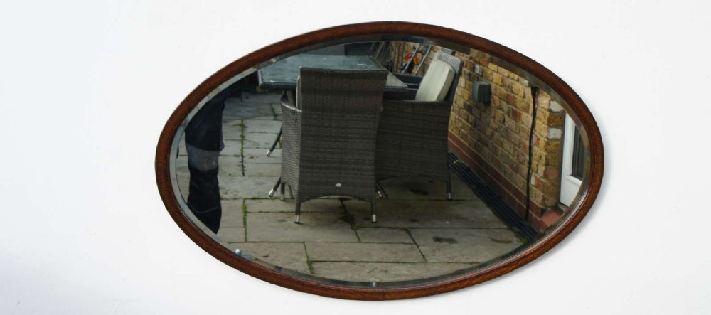large early 20th c oval oak wall or overmantle mirror