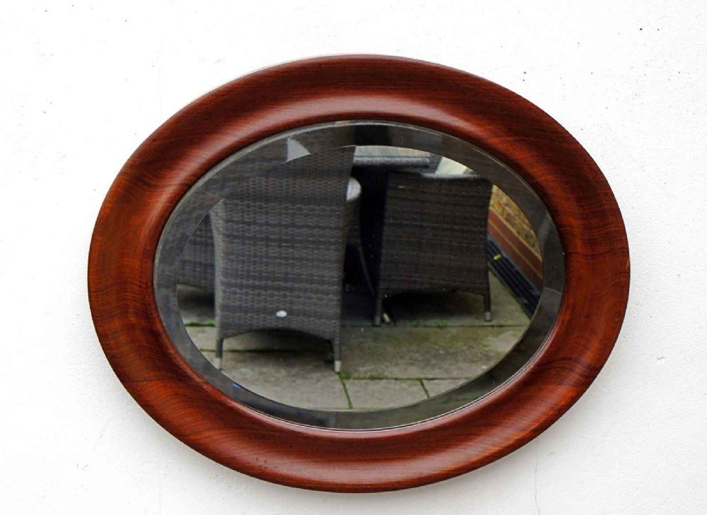 small stylish early 20th c oval mahogany deep framed wall mirror