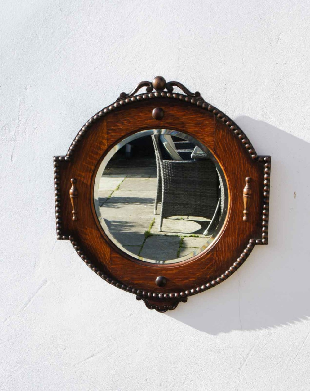 early 20th c circular carved oak jacobean style wallhall mirror