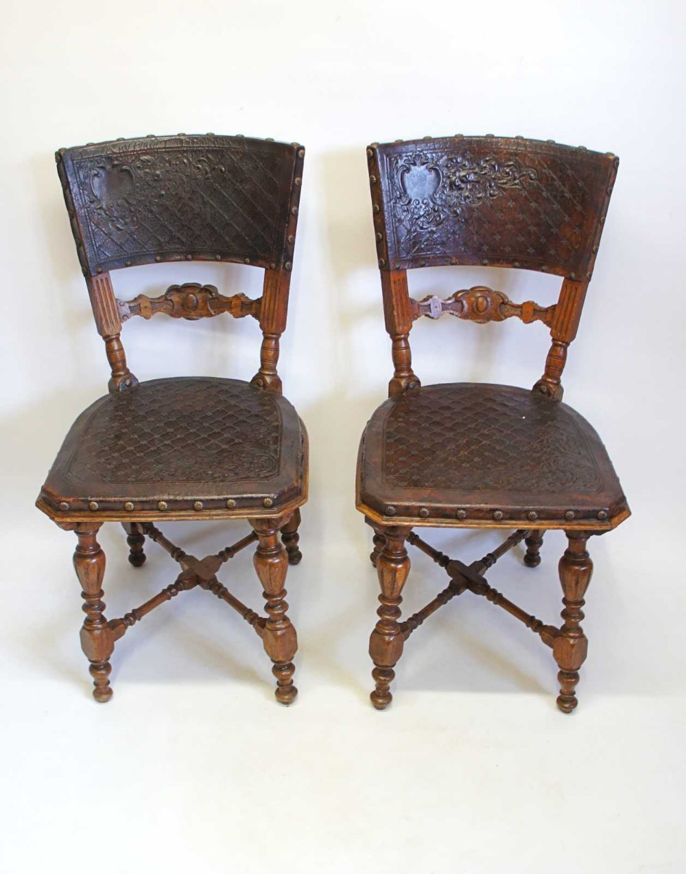 pair of 19th c continental oak studdedtooled leather dining chairs