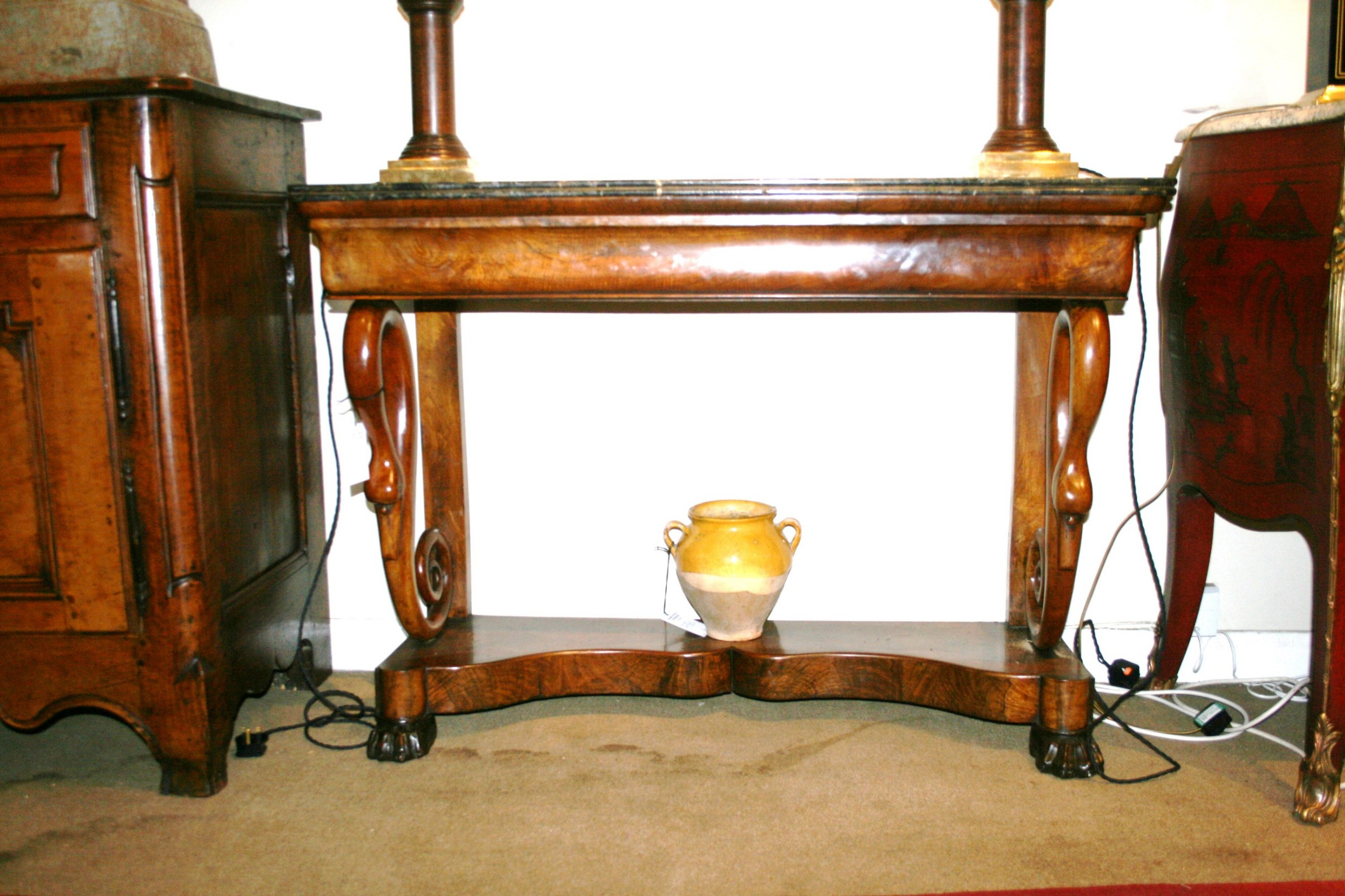 beautiful console table with carved swans