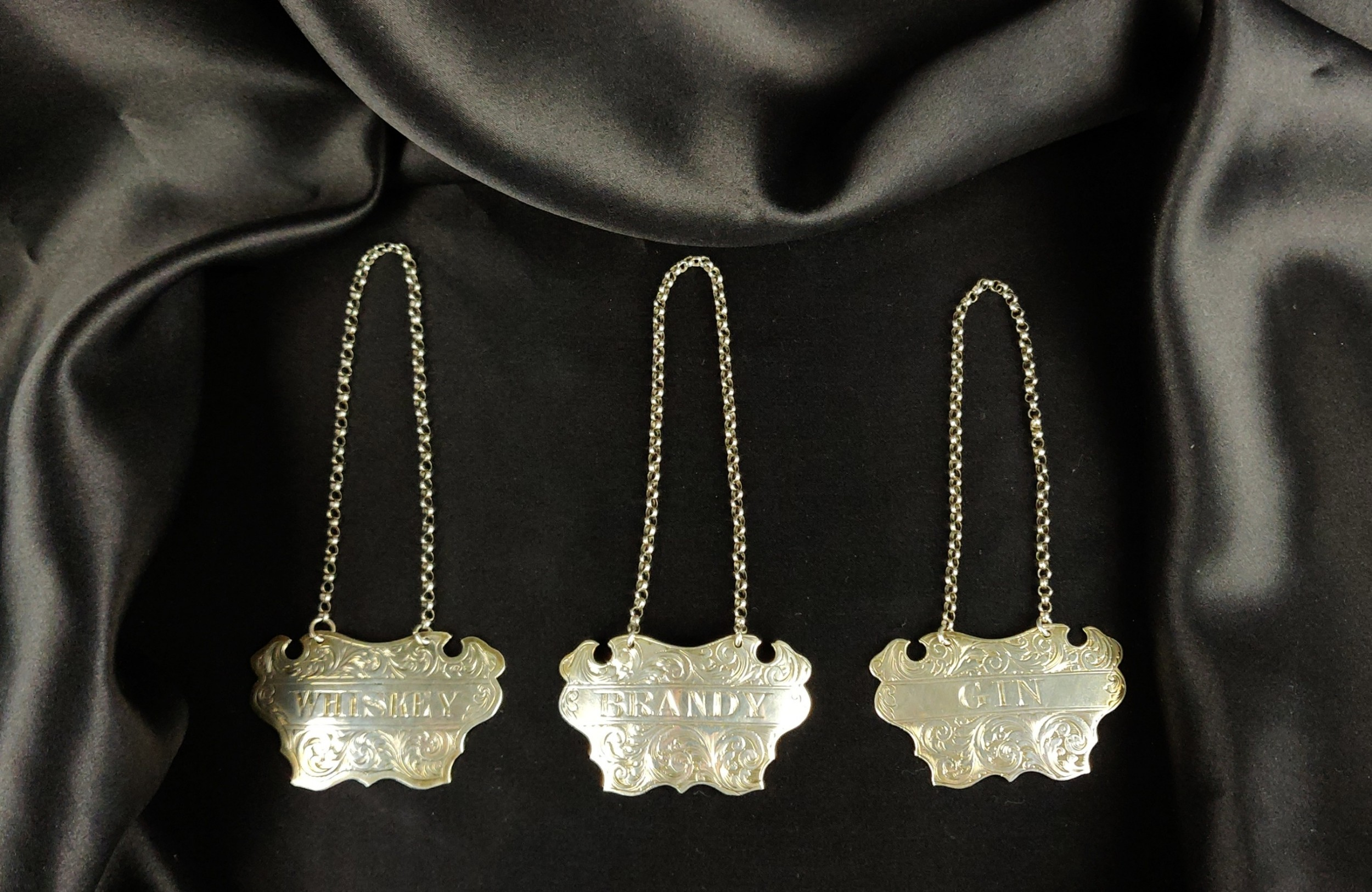 three victorian silver decanter labels